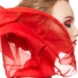 Stock Photo: Fashionable portrait of girl model with waving red silk scarf