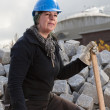 Stock Photo: Female manual worker in blue hard hat