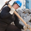Female worker with pickaxe — Stock Photo