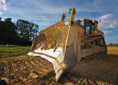 Dirty yellow bulldozer — Stock Photo