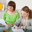 Girl doing prework with her mom — Foto Stock