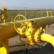 Yellow pipes and valve - Stock Photo