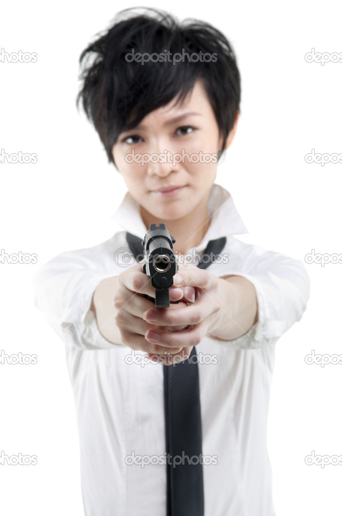 Cool Asian bodyguard holding a gun — Stock Photo #6757000