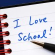 Stock Photo: Writing the words I love School in the notebook concept of education