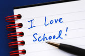 Writing the words I love School in the notebook concept of education — Stock Photo