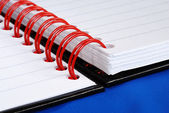 Close up view on the red spiral rings notebook concept of education or busi — Stok fotoğraf