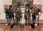 The exhibition in the Hermitage Museum, four horsemen in armor. — Stock Photo