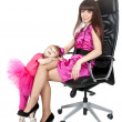 Mother and daughter in a chair — Stock Photo