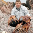 Man with crabs in the Barents Sea coast — Stock Photo