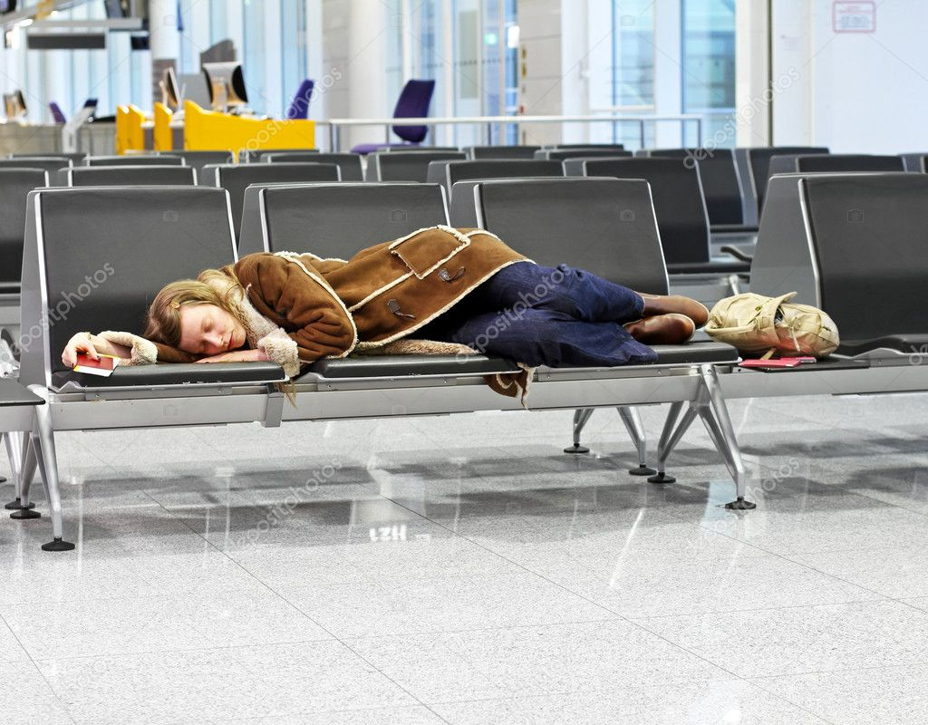 Passenger spending a night at airport after flight cancelation — Stock Photo #7800404