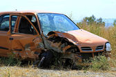 Crushed small car — Stockfoto