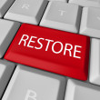 Stock Photo: Restore Key on Computer Keyboard - Save or Salvage Rescue