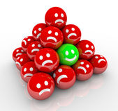 Happy Smile Face in Ball Pyramid of Sad Faces — Stock Photo