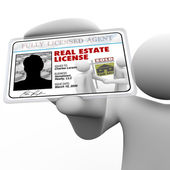 Real Estate Agent Holding License Laminated Identification Card — Stock Photo