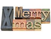 Merry Xmas in letterpress type — Stock Photo
