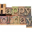 Happy holidays in letterpress type — Stock Photo