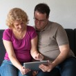 Middle-aged couple with digital tablet pc — Stock Photo #6861780