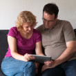 Middle-aged couple with digital tablet pc — Stock Photo