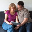 Middle-aged couple with digital tablet pc — Stock Photo #6861784