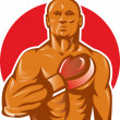 Boxer with boxing gloves hand on chest — Stock Photo #6996059