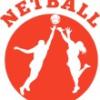 Netball player rebounding for ball - Stock Photo