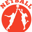 Netball player rebounding for ball — Stock Photo