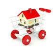 House in shopping cart isolated on white — Stock Photo