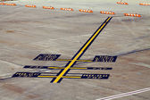 Airplane parking markings on airport tarmac yellow blue — Stock Photo