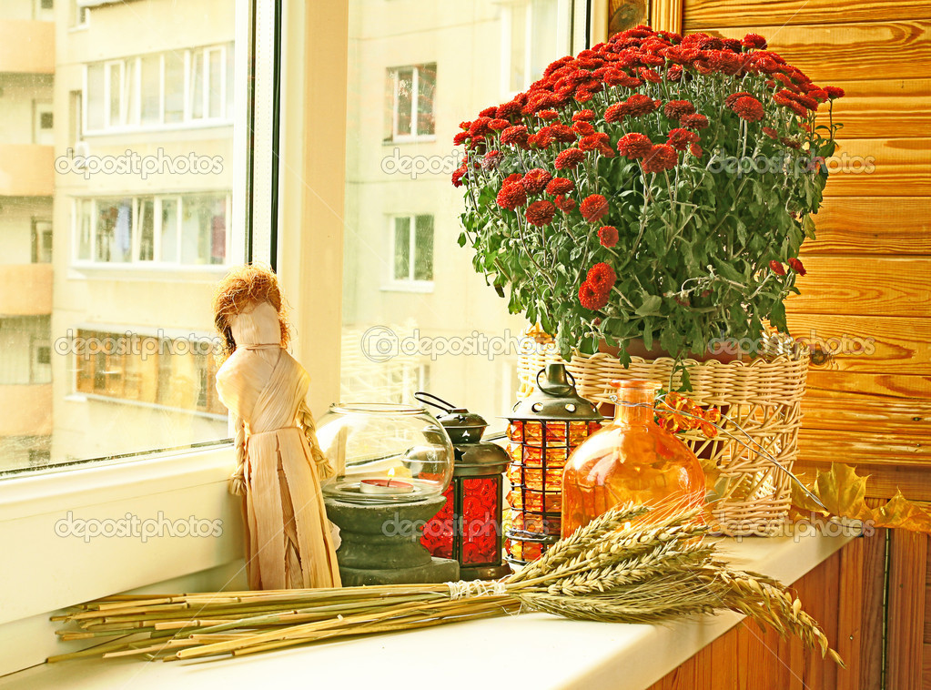 Creation of autumn mood on a balcony by candlesticks  Stock Photo #7424276