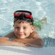 Kid into the swimming pool — Stock Photo