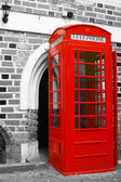 Red telephone booth — Stock Photo