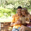 Stock Photo: Couple on a park bench
