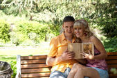 Couple on a park bench — Stock Photo