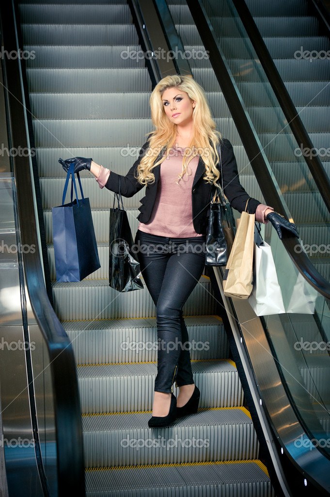 A blonde woman with lots of shopping bags — Stock Photo #6826328