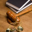 Scales of justice and gavel on desk with dark background - Stock Photo
