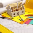 Stock Photo: Construction plans with helmet and drawing tools on blueprints
