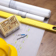 Construction plans and blueprints on wooden table — ストック写真