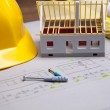 Construction plans and blueprints on wooden table — Stock Photo