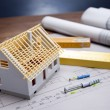 Construction plans and blueprints on wooden table — Stock Photo #7962753