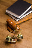 Scales of justice and gavel on desk with dark background — Stock Photo