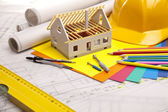 Construction plans with helmet and drawing tools on blueprints — Stock Photo