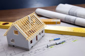 Construction plans and blueprints on wooden table — Стоковое фото