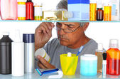 Middle aged man in front of medicine cabinet — Stockfoto