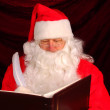 Santa Claus with Naughty and Nice Book — Stock Photo #6823819