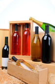 Assortment of wine bottles on crates — Stock Photo