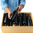 Stock Photo: Winemaker with case of wine