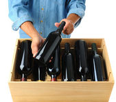 Winemaker with case of wine — Stock Photo