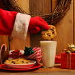 Santa Dunking Cookie — Stock Photo