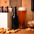 Beer and Peanuts in Rustic Setting - Stock Photo