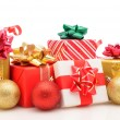 Stock Photo: Christmas presents and ornaments on white